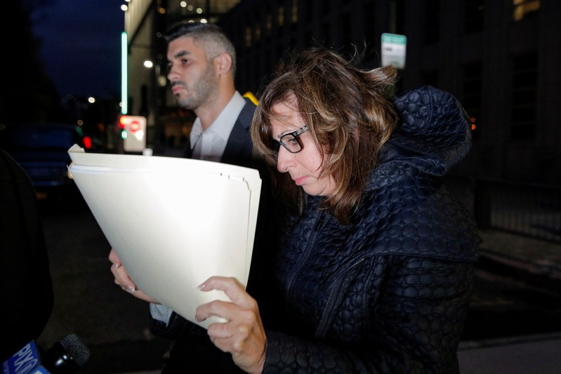 Frances Cabasso, owner and chief executive of Aventura Technologies Inc., exits Brooklyn Federal Court following her arraignment in the Brooklyn in New York